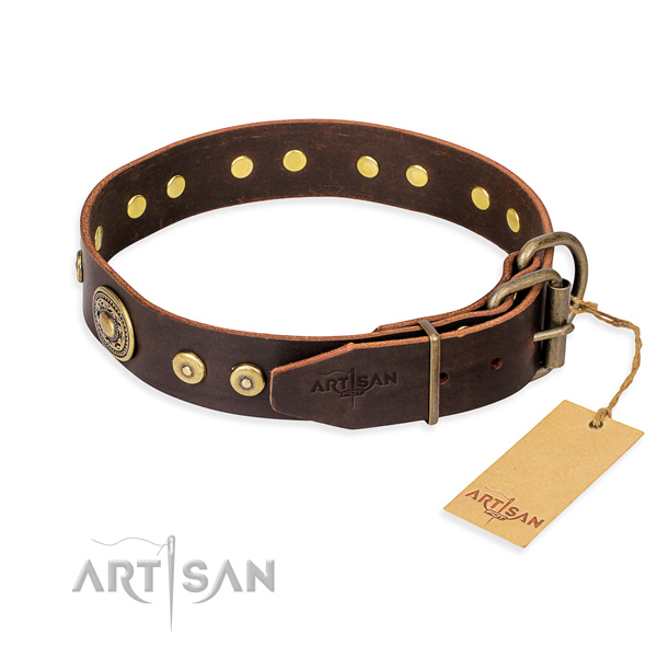 Full grain leather dog collar made of gentle to touch material with corrosion resistant embellishments